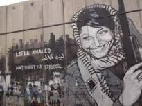 A graffiti portrait of Khaled on the Israeli separation wall near the occupied West Bank city of Bethlehem. (Source: Wikicommons)