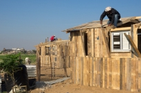In Beit Safiyya, a town in the northern Gaza Strip, local Palestinians are building homes from shipping crates in order to survive the winter. (Photo: Dan Cohen)